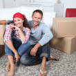 Couple moving in new house - Stock Photo