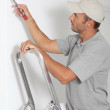 Man painting walls in white — Stock Photo #18265973