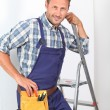 Electrician changing lamp bulb — Stock Photo