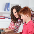 Teacher and children learning to use computer — Stock Photo