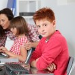 Teacher and children learning to use computer — Stock Photo #18266125