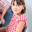 Shy little girl at school — Stock Photo
