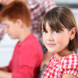 Shy little girl at school - Stockfoto