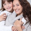 Woman and daughter at home — Stock Photo