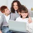 Mother and children surfing on internet - Stockfoto
