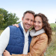 Closeup of happy couple in autumn - Stok fotoğraf