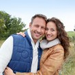 Closeup of happy couple in autumn - Stockfoto
