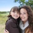 Closeup of mother and daughter in countryside - Stock fotografie