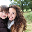 Closeup of mother and daughter in countryside - Stockfoto