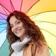 Beautiful smiling woman on a raining day - Stok fotoğraf