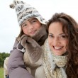 Closeup of mother and daughter in countryside — Stock Photo