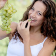 Closeup of woman eating grapes — Stock Photo