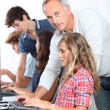 Stock Photo: Teenagers in computing class