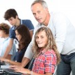 Teenagers in computing class — Stock Photo #18267931