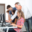 Teenagers in computing class — Stock Photo #18267935