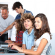 Stock Photo: Group of students sitting in classroom