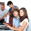 Group of students sitting in classroom — Stock Photo #18267953