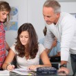 Teacher with students in classroom — Stock Photo #18268045