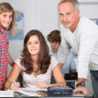 Teacher with students in classroom — Stock Photo #18268047