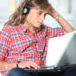 Teenager wth headphones and laptop computer — Stok fotoğraf