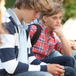 Teenaged boy with mobile phone — Stock Photo