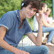 Teenage boy with headphones on — Stock Photo