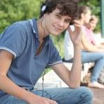 Teenage boy with headphones on — Stock Photo
