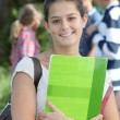 Closeup of student standing outside — Stock Photo #18268551