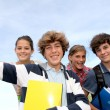 Group of teenagers studying outside the class — Stock Photo #18268557
