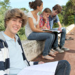Teenagers studying outside the class — Stock Photo