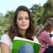 Teenagers studying outside the class — Stock Photo #18268581