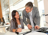 Manager and businesswoman meeting in office — Foto Stock