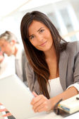 Beautiful businesswoman using electronic tablet — Stock Photo