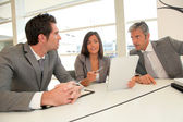 Business meeting with electronic tablet — Stock Photo