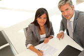 Business partners signing contract — Stock Photo