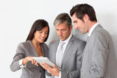 Business meeting in hall with tablet — Stock Photo