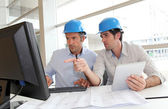Architects working on construction plan — Stock Photo