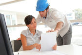 Architects working in office with electronic tablet — Stock Photo