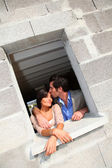 In loved couple standing in their future house — Stock Photo