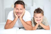 Closeup of father and son at home — Stok fotoğraf