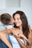 Little boy kissing her mom — Stock Photo