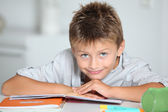 Little boy doing his homework — Stock Photo