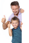 Closeup of man with little boy showing message — Stock Photo