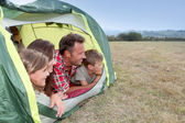 Parents and children in camp tent — Stock Photo