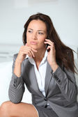 Closeup of businesswoman talking on mobile phone — Stock Photo