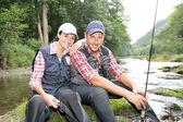 Man and woman in river fly fishing — Stockfoto