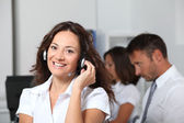Beautiful woman with headset on — Stock Photo