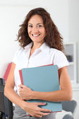 Beautiful woman standing in the office — Stock Photo