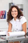 Closeup of smiling businesswoman wearing eyeglasses — Stock Photo