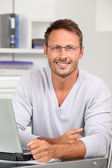 Portrait of handsome man wearing eyeglasses — Stock Photo